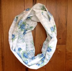 This pretty little scarf is crafted from vintage fabric found in Tennessee and features bonnie blue roses against a white background with a white plaid- perfect for pairing with an airy spring dress!  Limited run of FOUR. Handmade in Nashville, TN from a vintage cotton. nytonashville.com