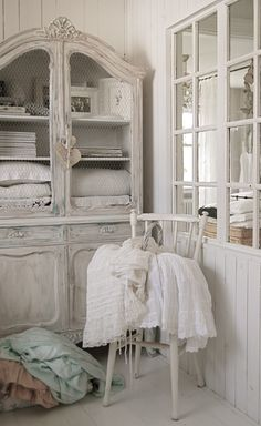 white washed armoire with chicken wire panels