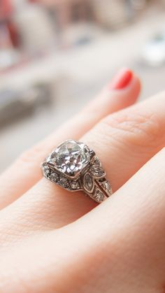 Nature-inspired art deco vintage engagement ring with a 1.80 carat diamond made in platinum.