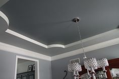 Great way to paint a tray ceiling and break up the colors....one shade darker on the ceiling insert broken up by white makes them not compete if they aren't the exact same color family. Fantastic!