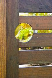 Hardwood timber gate with circular hole for gate latch.