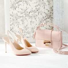 Pretty in a (pink) Jimmy Choo crossbody and Charlotte Olympia heels.