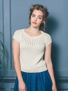 Kiku - Knit this women's lace and cable stitch top from the Cotton Lustre Collection, a design by Sarah Hatton using the gorgeous yarn Cotton Lustre (cotton, modal and linen). With a delicate lace detail on the yoke and sleeves, wide round neck, cap raglan sleeves with ribbed welt, this knitting pattern has a three star difficulty rating.