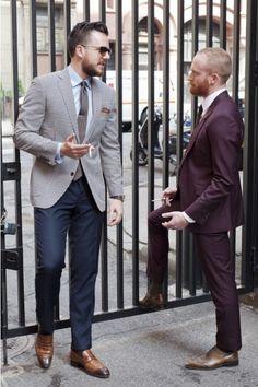 Men's Grey Polka Dot Blazer, Blue Dress Shirt, Brown Polka Dot Silk Tie, Navy Dress Pants, Brown Socks, Brown Leather Loafers, and Brown Sil...