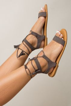 Embrace timeless style this summer with the Ancient Athens Sandals in Grey! These beautiful matte grey sandals feature an open design, a faux suede finish, and a lace up front with tie closure, adding