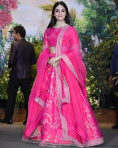 You can be assured to make a great style statement with this pink thai silk lehenga. This lehenga is enhanced with embroidery work all over.Buy this latest designer lehenga choli online .Paired with matching choli and net dupatta Sabyasachi Lehenga Bridal, Lehenga Choli Wedding, Party Wear Lehenga, Indian Lehenga, Indian Gowns, Indian Attire, Anarkali, Alia Bhatt Lehenga, Pink Bridal Lehenga
