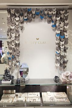 repetitive pattern. visual merchandising by Construct could put butterflies in a small window or hanging from ceiling in store