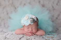 newborn girl with tutu criss-cross pose