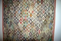Lilymarlene's Patchwork Blog: More hexagon quilts.  This was an antique quilt in the Kaffe Fasset stand at a quilt show. There were a lot of antique quilts on his stand to show where he got his inspiration from.