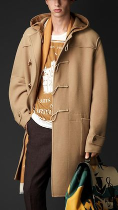 Burberry Prorsum Camel Double Cashmere Wool Duffle Coat - A super-lightweight double construction duffle coat. Crafted from air-spun double cashmere and wool, the coat is unlined with dropped shoulders and an adjustable hood. A pronounced yoke, patch pockets and rope toggle cords reference heritage designs.  Discover the men's outerwear collection at Burberry.com
