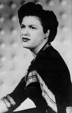 the first woman inducted into the country music hall of fame...she's my girl..............(patsy cline)