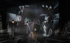 Emil and the Detectives. Set design by Bunny Christie. Lighting by Lucy Carter. Notes: Characters are side-lit so that the projections can play out in the background without interruption.