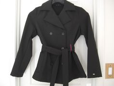 This cute trench coat has not been altered in any way so please, if you return it, return it in the same condition (with tags) as you received it. Belted at waist; belt loops. Machine wash.