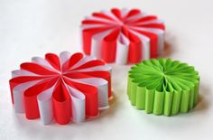 Use red and green paper to make these festive flower ornaments.