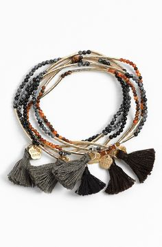 Boho chic bead and tassel stretch bracelets.