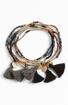 Boho chic bead and tassel stretch bracelets.