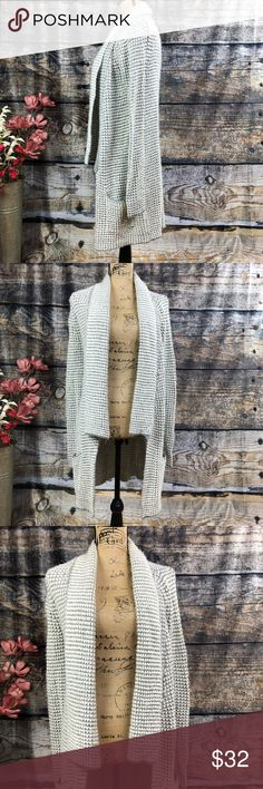 "Very Wang Princess super soft pocketed cardigan Vera Wang Princess super soft pocketed cardigan  Lovely grey and white with silver threading  Like wearing a blanket  Cascade front Great side pockets BOHO appeal  Softest ever! Preloved in excellent condition  Pit measurement approximately 16"" Length approximately 34""   Thank you for checking out our closet Please feel free to bundle and save  E21 Vera Wang Sweaters Cardigans"