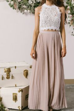 Our Classic Collection wouldn't be complete without a pleated maxi skirt! Pleats are so chic and timeless, and the pretty...