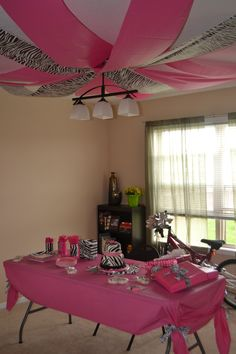 use black table runners for the patio ceiling with white and pink streamers!!