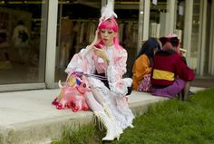 """A participant dressed in the so-called """"Lolita"""" style works on her make up as…"""