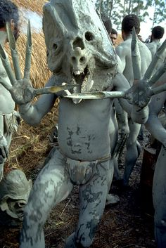 Asaro tribe warriors in mud and pig's faces at Mount Hagen Sing-Sing, Papua New Guinea