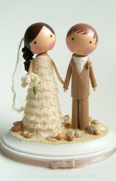 precious cake topper.  I know I am already married, and have absolutely no use for this, but ADORABLE!