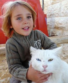 Afghan girl & her cat