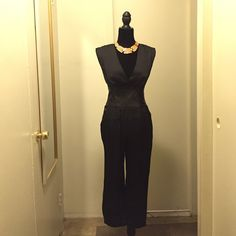 Black V-Neck Bebe Jumpsuit Black v-neck jumpsuit with zipper closure down the back. Slit pockets on the sides. Faux leather waist band. (Necklace not for sale). Price is firm. bebe Pants Jumpsuits & Rompers