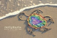 Carly Marie makes absolutely gorgeous art in the sand :) she does this for families who have had to go through the trauma of having a sleeping baby born. God has truly blessed Carly Marie with amazing talent :) ♡♥♡♥♡♥♡ www.carlymarieprojectheal.com