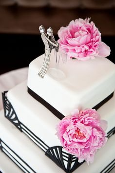 Art deco inspired cake. I kind of hate the flowers and the cake topper but the rest is divine.