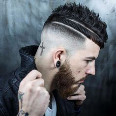 Right View: Skin fade... double razored part... half blunt fringe... textured on top... cross ✝️. Styled with @apothecary87 clay pomade. Hair & photography: @r.braid Model: @kut_throat_kai #BraidBarbers #BarberShop #UkBarbers #BarbersUk #BritishBarber #ModernBarber #ModernSalon #BarberLife #BarberLove #MensHair #MensFashion #MensStyle #HairMenStyle #RBraid #PhotoArt #HairArt #Tattoo #BeardLove #InternationalBarbers