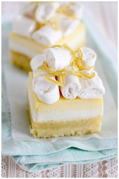 Lemon almond cake with vanilla buttermilk panna cotta and lemon curd, topped with baked meringue and candied lemon zest.