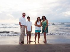 Fun family portraits on a Maui beach at sunset. View more at: https://mauiislandportraits.com/family-portraits-on-a-maui-beach-2/