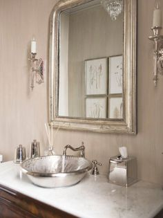 Love the mercury glass mirror and the silver tome bowl sink.
