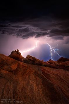 This shot is a two exposures blend (one for the foreground and one a lucky 30 seconds wait for the lighting strike) combined in PS. The image was taken in the Valley of Fire, Nevada last week during the monsoon season (still going on). Please notice the color differences the right lighting developed. Very interesting....