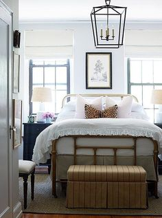 Eclectic and feminine mix of styles in this cozy bedroom design.