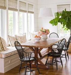 table and chairs. Love the rustic table and dark Windsor chairs.