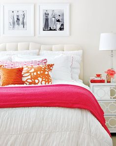 White Bedroom with Orange and Hot Pink Pillows and Throw