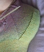 A different type of toe-up gusset heel... exactly the same as a cuff-down one, pick-ups and all! I think it looks very tidy.