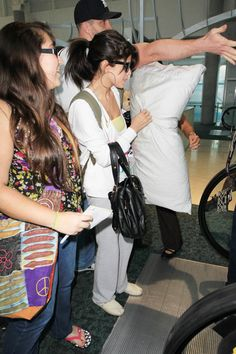 Former Disney star Selena Gomez is seen attracting attention as she arrives at Miami Airport.