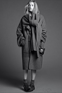 The Row cashmere coat, $23,500, Amaree's, jacket and scarf, similar styles available at Neiman Marcus, and Prada cashmere knit, $1,190