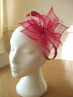 I love this colour and shape:) Hot pink Petals Sinamay Fascinator on a comb. by joannelamacraft, £16.00