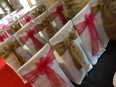 Raspberry pink organza sashes alternated with hessian/burlap sashes on white chair covers x