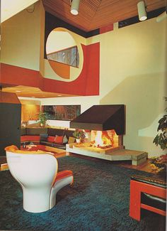 70's Interior Design.  Sunken rooms were the rage in the 70s (far back left), but check out the circular aperture and the fireplace.... so groovy!