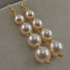 Handmade Creamrose Glass Pearl Dangle Earrings On Gold Hooks. Graduated glass pearls from , and separated by rhinestone collars. Jewelry Design Earrings, Custom Earrings, Bead Jewellery, Beaded Earrings, Custom Jewelry, Earrings Handmade, Beaded Jewelry, Jewelery, Diy Schmuck