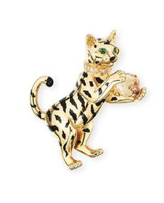 A GOLD AND MULTI-GEM CLIP BROOCH, BY CARTIER   The polished gold baby tiger with onyx nose and black lacquer stripes holding a citrine ball, enhanced by a diamond-set collar and circular-cut emerald eyes, mounted in 18k yellow and white gold, 5.8 cm high, with French assay mark for gold, in red leather Cartier case