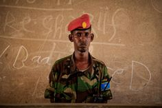 A soldier of the Somali National Army (SNA) stands during a graduation ceremony for platoon commanders and non-commissioned officers at the African Union Mission in Somalia (AMISOM) Jazira training facility in the Somali capital Mogadishu.  AU-UN IST PHOTO / STUART PRICE.