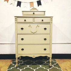 Antique chest of drawers painted with General Finishes Millstone milk paint and top-coated with their satin finishing wax.