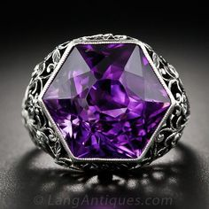 Vintage Silver and Hexagonal Amethyst Ring, A luscious deep purple amethyst, with a striking hexagonal cut, gleams from atop a gorgeous silver mounting adorned throughout with baroque filigree ornamentation. Unique and stunning. The gemstone measures 5/8 inch from tip-to-tip.