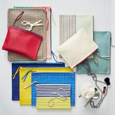 The perfect pop of color. Our Leather Stripe Zipper Cases feature happy hues with contrasting zippers. Available in three sizes, they're a must for traveling or storing accessories on a dresser.